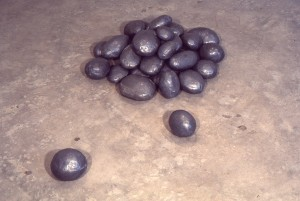 Pile of lead rocks on concrete  -